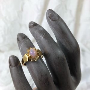 Avon gold tone ring with opal style stone SZ 6.75